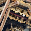 Dried gourds hanging on the beams in a house — Stock Photo #27750207