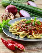Ravioli pasta with red tomato sauce — Stock Photo
