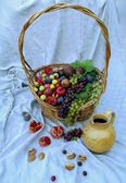 Still life with a fruit basket — Stock Photo