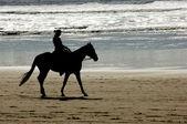 Horseback riding on Cannon beach — Stock Photo