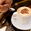 Drinking capuccino — Stock Photo