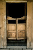 Authentic saloon doors in western town — Stock Photo