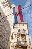 Croatian flag above old part of Rab — Stock Photo
