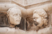 Sculptured heads of St James Cathedral — Stock Photo