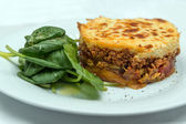Moussaka with spinach leaves — Foto Stock