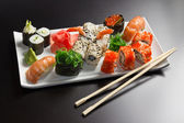 Japanese seafood sushi , rolls and chopstick — Stock Photo