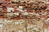 Old crumbling plastered brick wall — Stock Photo