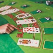 Стоковое фото: Black Jack casino table with croupier hand