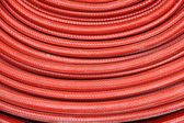 Red fire hose winder — Stock Photo