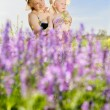 Mom and daughter with flowers — Stock Photo #20616471