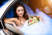 Beauty in the wedding car — Stock Photo