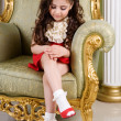 Small beauty in a chair — Stock Photo