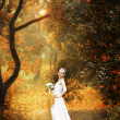 Bride on autumn forest — Stock Photo