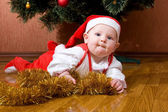 Little baby Santa with gifts — Stock Photo