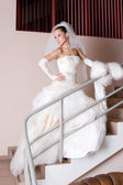 Serious bride on the staircase — Stock Photo