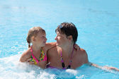 Girl with grandmother in the swimming pool — Stock Photo