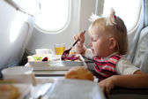 Eating in the airplane — Stock Photo