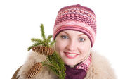 Girl with a branch of fur tree girl with a branch of fur tree — Stock Photo