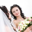A beautiful bride looking into the mirror — Stock Photo