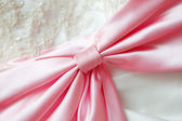 Large pink silk bow — Stock Photo