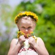 Small beauty with dandelions — Stock Photo
