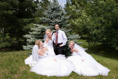 One groom with three brides — Stockfoto