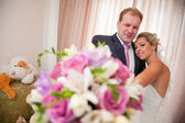Couple with bouquet — Stock Photo