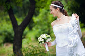 A bride near the tree — Stock Photo