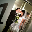 Stock Photo: Kiss in the lift