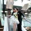 Bride and groom in metro — Stock Photo
