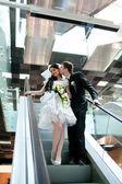 Bride and groom in metro — Stock Photo