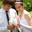Stock Photo: Couple with pigeons