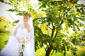 Bride with orchids — Stock Photo