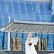 Royalty-Free Stock Photo: Bride near the modern building