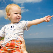 Royalty-Free Stock Photo: Child pointing forward