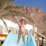 Happy little girl on slide — Stock Photo
