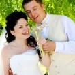 Newly married couple with white dandelions — Stock Photo
