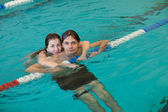 Couple in a swimming pool — Stock Photo