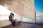 Couple under the sail — Stock fotografie