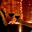 Red wine and hands of lovers — Stock Photo
