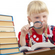Girl reading with loupe - Stock Photo