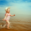 Happy girl on the beach - Stock Photo