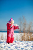 Child throwing snow in winter — Stock Photo