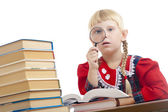 Girl reading with loupe — Stock Photo