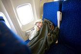 Child sleeping in plane — Stock Photo
