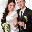 Bride and groom with champagne — Stock Photo