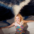 Young girl sitting on the yacht — Stock Photo #22915076