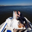 Happy couple having picnic on the yacht — Stock Photo