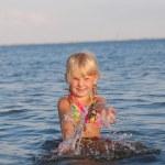 Splashing in the water child — Stock Photo