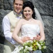 Stock Photo: Bride and groom near wall